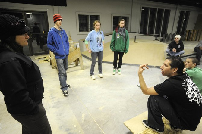 Sk8 Church founder Buck Chavarria talks to, from left, City of Steamboat Springs Teen Programs Coordinator Brooke Lightner, and Steamboat Springs Teen Council members Nick Parnell, Maria Hillenbrand and Chloe Banning on Wednesday during a tour at the Sk8 Church facility.