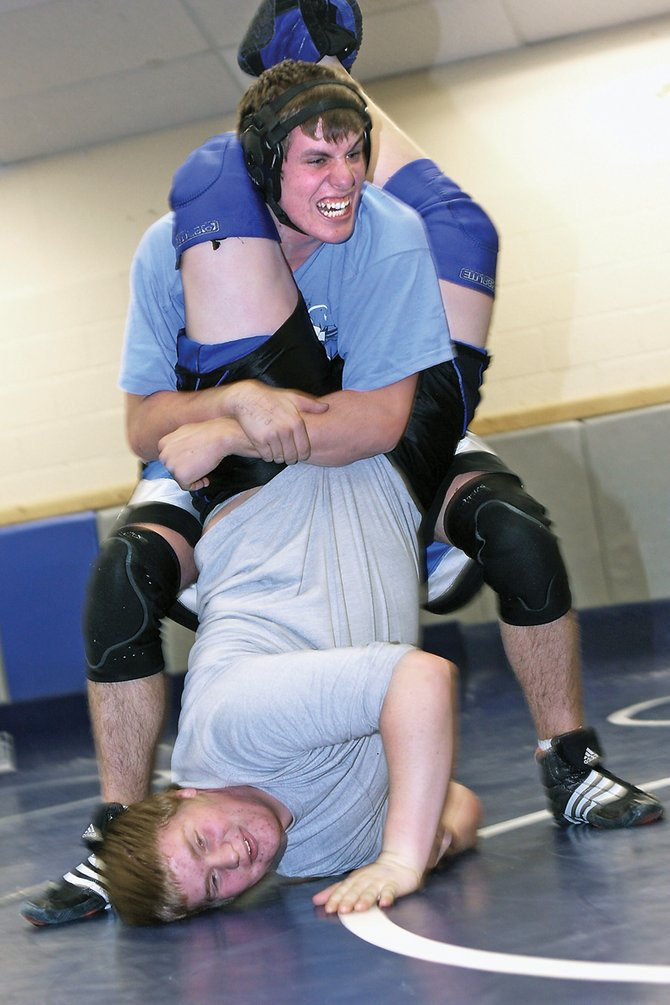 Cody Adams, top, grapples with Ben Winslow during wrestling practice Wednesday night at the Moffat County High School wrestling room. The team will wrestle at the regional tournament today and Saturday at Mullen High School in Denver.