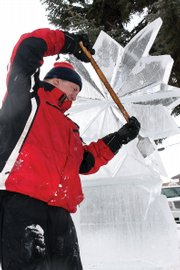 Michael Campe uses a flat ice chisel to form a snowflake ice sculpture to be featured at Alice Pleasant Park. Campe, who has been creating ice sculptures for 25 years, was the Colorado team captain at the 1990 Ice Sculpture World Championships in Ontario, Canada. The team represented the United States at the international event and took fourth place.