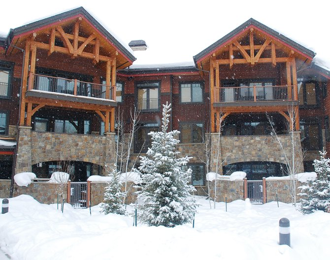 Ground-level condominiums at Bear Lodge are made more desirable by patios secluded behind stone walls where there is an outdoor fireplace and eight-person hot tub.