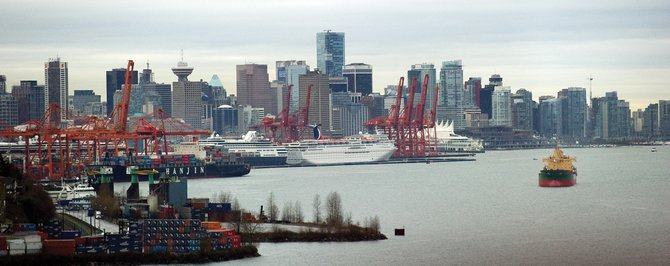 The view of Vancouver, British Columbia, on  Thursday from the highway leading to Whistler.  Vancouver will host the opening ceremonies today for the 2010 Olympic Games at BC Place, a 60,000-seat indoor venue.