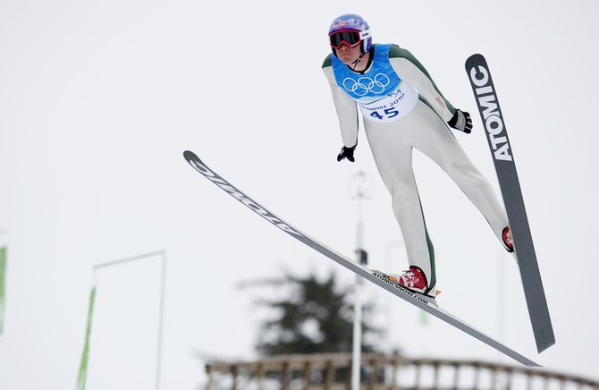Billy Demong hits a training jump Saturday at Whistler Olympic Park in British Columbia. He and his U.S. Nordic Combined Ski Team teammates are scheduled to compete in an individual event Sunday.