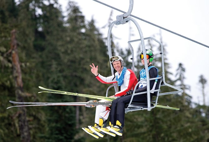 Steamboat Springs Nordic combined skier Todd Lodwick rides up the chair lift at the Whistler Olympic Park for Friday afternoon&#39;s training round. Lodwick and his teammates on the U.S. Nordic Combined Ski Team, are busy preparing for their first event, the normal hill individual Gundersen, on Sunday.