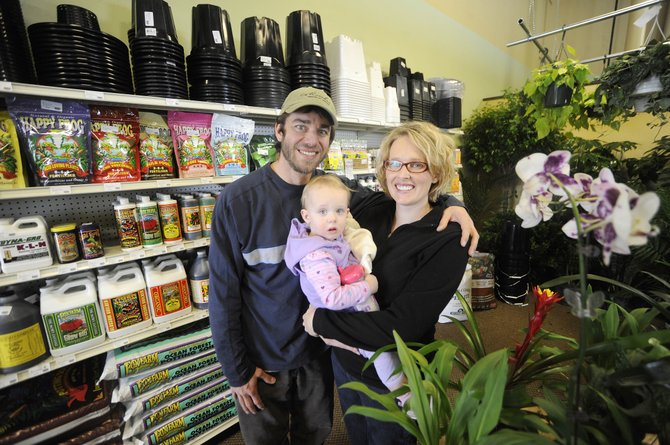 Little Shop of Growers owners Greg and Kristen Pappas, pictured with their daughter, Parker, opened their gardening business at the beginning of January. Many of the items sold in the store cater to indoor growers.