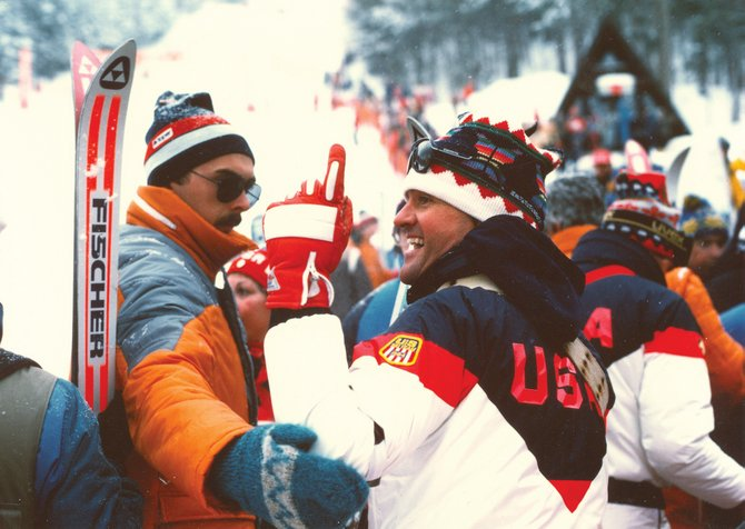 John McMurtry, right, celebrates after Deb Armstrong's gold medal slalom run during the 1984 Winter Olympics.