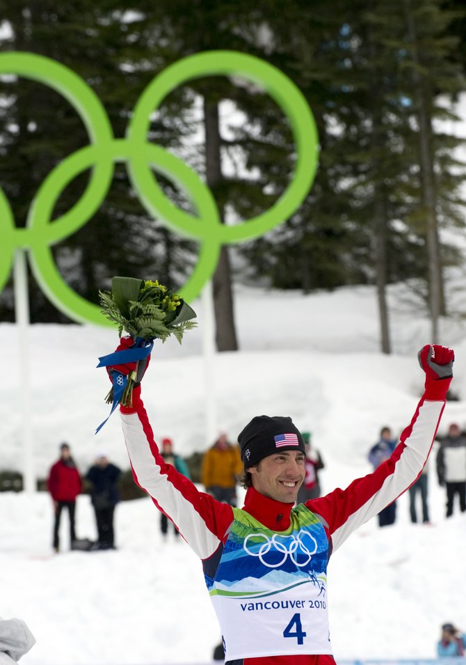 Johnny Spillane stands on the podium at the cross-country venue in Whistler Olympic Park. Spillane raced to second place in the normal hill individual Gundersen event and became the first American to earn a medal in the sport of Nordic combined.