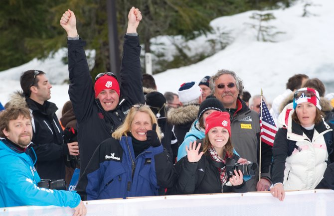 Members of Johnny Spillane's family, including mom Nancy, left center, and wife Hilary, right center, react after Johnny won silver medal in the normal hill individual Gundersen event at the Winter Olympics.