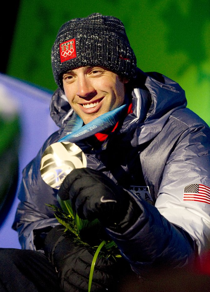 Johnny Spillane shows off his silver medal at the Whistler Oympic Celebration Plaza on Sunday night. His win ended the U.S.'s 86-year Nordic combined drought at the Olympics.