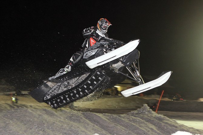 Wes Selby, of Grand Lake, airs through the rhythm section of the Snocross track during the X-treme Mountain Racing event Saturday night at the Wyman Museum's Winter Festival. Selby won $2,000 for his first-place finish in the semi-pro class.