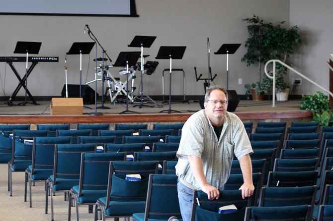 Pastor Len Browning stands Monday in the new, $2.5 million sanctuary expansion at The Journey at First Baptist. The expansion is the first major renovation to the church since 1975.