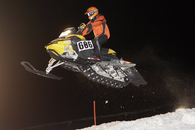 Wesley Chapman airs over the final jump during X-treme Mountain Racing on Saturday night at the Wyman Museum's Winter Festival. Chapman took first place in the junior 14-15 class.