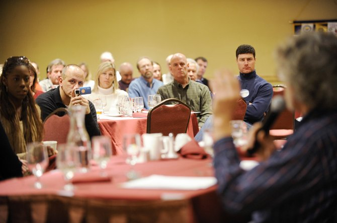 Steamboat Springs Rotary Club members and guests listen to affordable housing advocate John Spezia speak against the Steamboat 700 annexation during Tuesday's meeting at The Steamboat Grand.