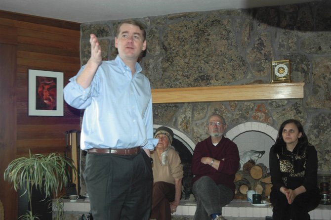 U.S. Sen. Michael Bennet, D-Colo., spoke about topics including health care and partisan politics Monday morning with about 25 Steamboat residents, including, seated from left, Anna Fields, Myron Fields and Vesna Palmer.