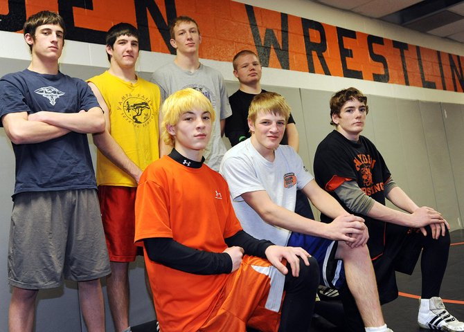 Hayden's state-bound wrestlers: top, from left, Scott Armbruster at 125 pounds, Koleman Williams at 152, Treyben Letlow at 215, Will Valora at heavyweight, T-Lane Mazzola at 103, Nick Williams at 135 and Chad Terry at 119.