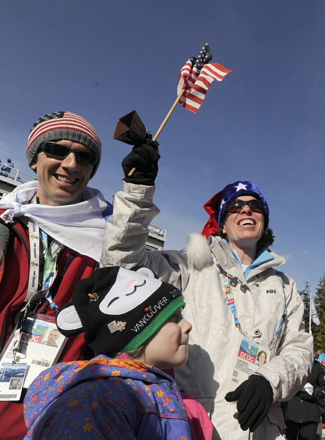 American downhill ski fans Arnold Blinn and Leslie Brewer, of Seattle, show their support for the American skiers during Wednesday's women's downhill event at Whistler Creekside.