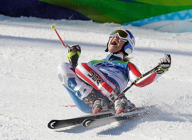 American Lindsey Vonn celebrates her gold medal run in the finish area at Whistler Creekside on Wednesday morning. Vonn took the gold, and her teammate Julia Mancuso won silver in the women's downhill event.