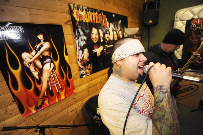 XIII vocalist Guy Del Hierro screams into the microphone during Thursday's rehearsal. XIII plays with Subject to Blackout and Novus Folium at 10 p.m. today at Old Town Pub. Cover is $5.
