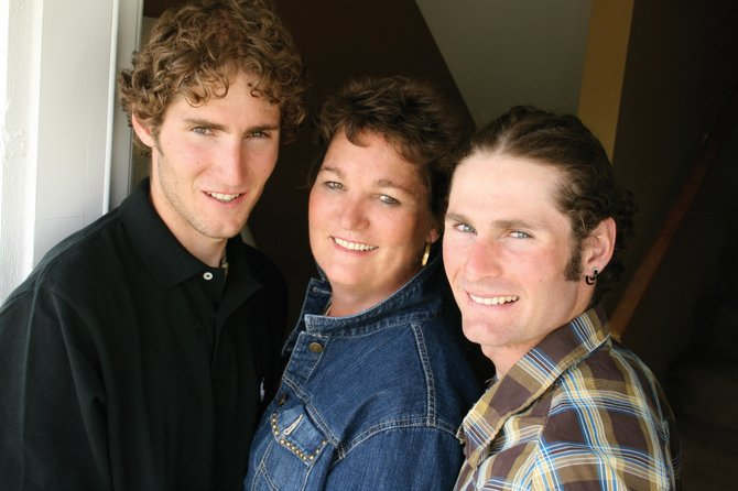 The Fletchers, from left, Taylor, Penny and Bryan, in 2009. Taylor Fletcher is on the U.S. Nordic Combined Ski Team. His mother wasn't sure she would be able to make the trip to Vancouver, British Columbia, because of the cost, and after receiving a grant from Procter & Gamble to help her with the trip, she has been enjoying the experience. Bryan Fletcher just missed the Olympic cut but is forejumping in Whistler this week, as well.