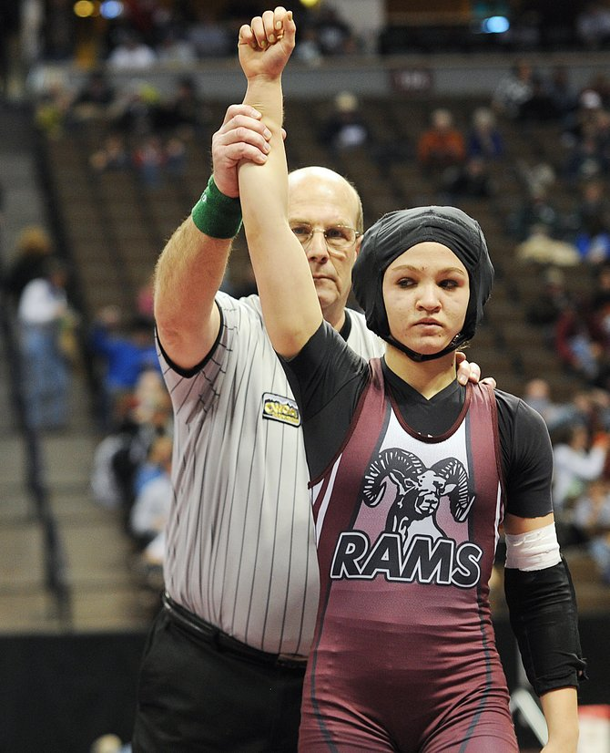 Lauryn Bruggink is named the winner of her first-round consolation match in the 103-pound bracket of the Class 2A state wrestling tournament in Denver today. With a first-round pin, she became the first girl to ever win a match at the state tournament. Cody Pfau of Meeker became the second about 10 minutes later.