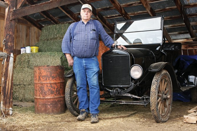 Lou Wyman stands next to his 1926 Ford he is storing in a barn at the Wyman Museum. On Friday night, Wyman was named the Craig Daily Press/KRAI Citizen of the Year during the Craig Chamber of Commerce's State of the County event.