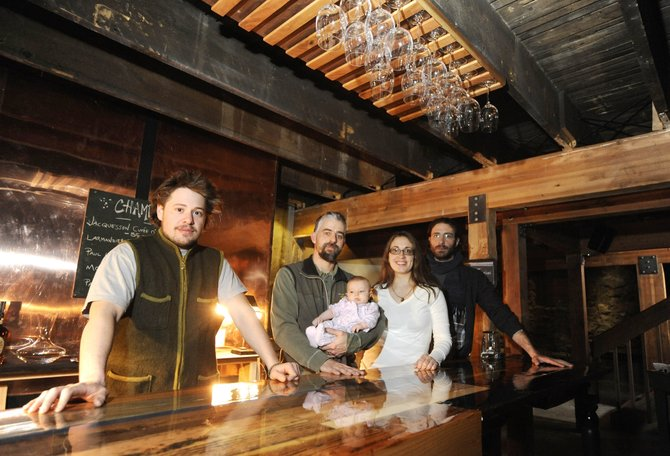 Bella's owners, from right, Nick Ciraldo, his sister Lisa Ciraldo-Freese, her husband, Michael Freese, and their daughter Bella are pictured. The owners worked with designer Vahakn Matossian, left, to transform the space below Chocolate Soup Pastry Café into a downtown wine bar.