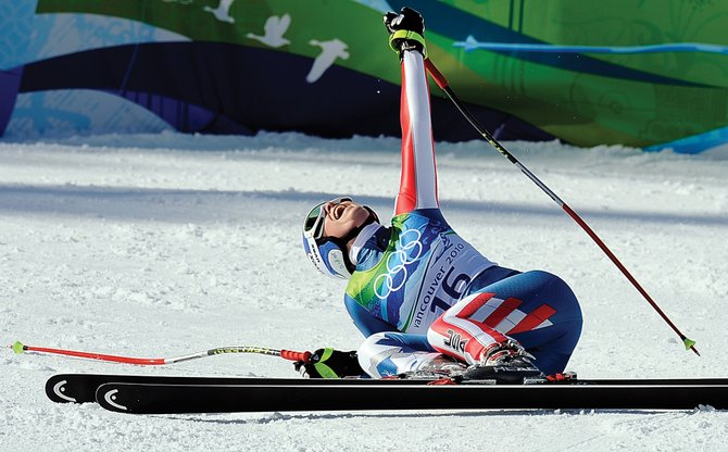 American Lindsey Vonn celebrates her gold medal run in the finish area at Whistler Creekside on Wednesday morning. Vonn and American teammate Julie Mancuso went 1-2 in the women's downhill race.