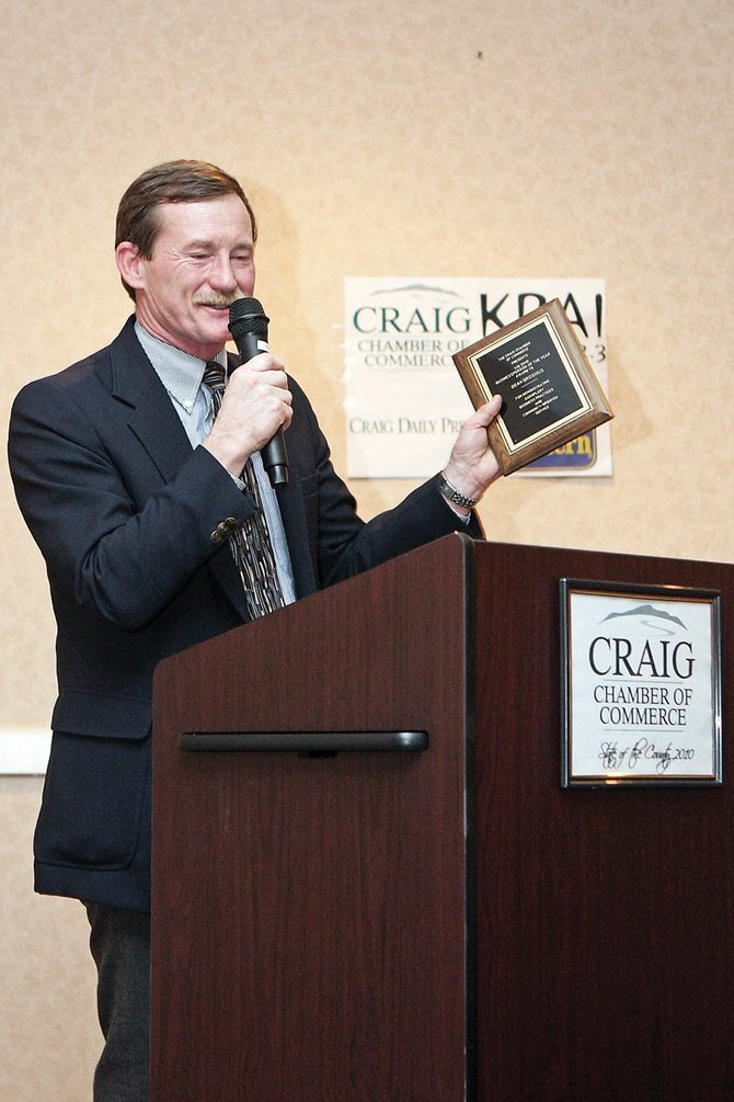 Dean Brosious, owner of LPL Financial Services, accepts the Businessperson of the Year award at the State of the County event Friday night at the Holiday Inn of Craig. Brosious opened LPL five years ago in downtown Craig after working for Bank of Colorado.