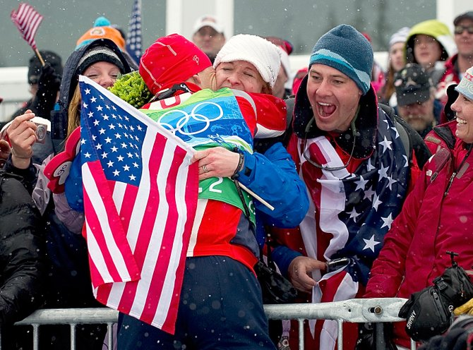 Nordic combined skier Todd Lodwick hugs his wife, Sunny, after the Americans won the silver medal in the team event at Whistler Olympic Park in British Columbia this afternoon.