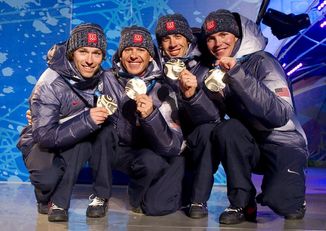 Members of the U.S. Nordic Combined Ski Team show off their silver medals at the Whistler Olympic Celebration Plaza. The team, which includes, from left, Brett Camerota, Todd Lodwick, Johnny Spillane and Billy Demong, raced to second place in the team event.