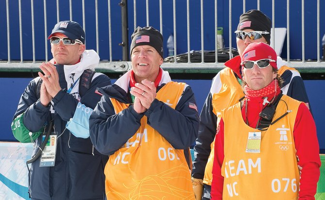 U.S. Nordic combined coach Dave Jarrett, right, watched Thursday afternoon's Nordic combined flower ceremony at Whistler Olympic Park. Jarrett was joined by, from left, U.S. Ski Team Nordic Director John Farra and assistants Greg Poirier and Chris Gilbertson.