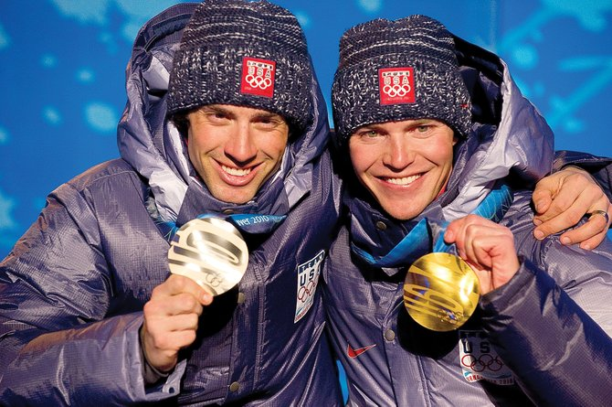Olympic gold medalist Billy Demong, right, shares the stage at Whistler Olympic Celebration Plaza with his teammate Johnny Spillane. The pair dominated Thursdays large hill individual Gundersen event. Steamboats Spillane, who was second in the normal hill individual Gundersen event Feb. 14, earned the silver to cap off the U.S. Nordic Combined Ski Teams best showing at an Olympics. The pair also earned silver in the Nordic combined team event Tuesday along with Brett Camerota and Todd Lodwick.