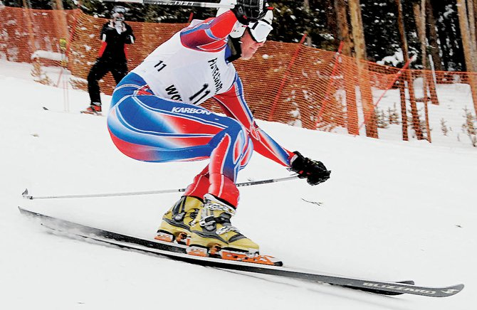 Shane Anderson, with the Steamboat Springs Winter Sports Club, touches down after clearing a jump in the classic race at the FIS Telemark World Cup Race at Keystone Resort on Thursday.