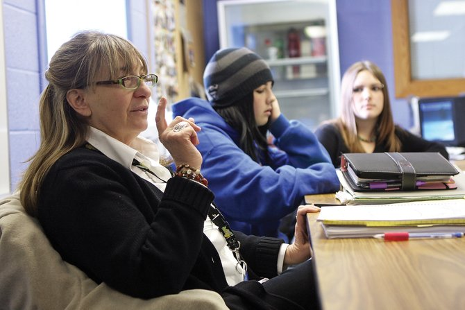 Joanne Snow, a social worker with the Moffat County School District, leads a lesson Thursday at the Boys & Girls Club of Craig while Shene Chamberlain, center, and Hannah Everding listen. Snow teaches a few sessions each week at the Moffat County Alternative School, which offers flexibility and independent studies to high school students in a different setting.