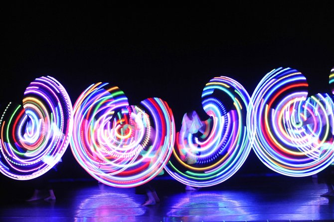 """Dancers perform """"The Glow Show,"""" which is choreographed by Jessica Hale and Jennifer Harlan, on Wednesday during a dress rehearsal for the 38th annual Steamboat Dance Theatre concert in the Steamboat Springs High School auditorium."""