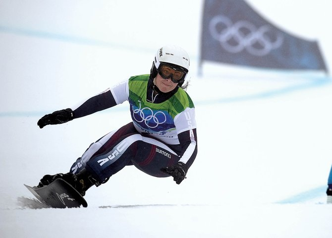 Michelle Gorgone, a 2001 Lowell Whiteman School graduate, competes in the parallel giant slalom snowboard race Friday at the snowboarding venue at Cypress Mountain. Gorgone was eliminated by Russian Ekaterina Ilyukhina in the round of sixteen. Friday's race was marked by periods of heavy rain, fog and more than a little disappointment for riders with ties to Steamboat Springs.