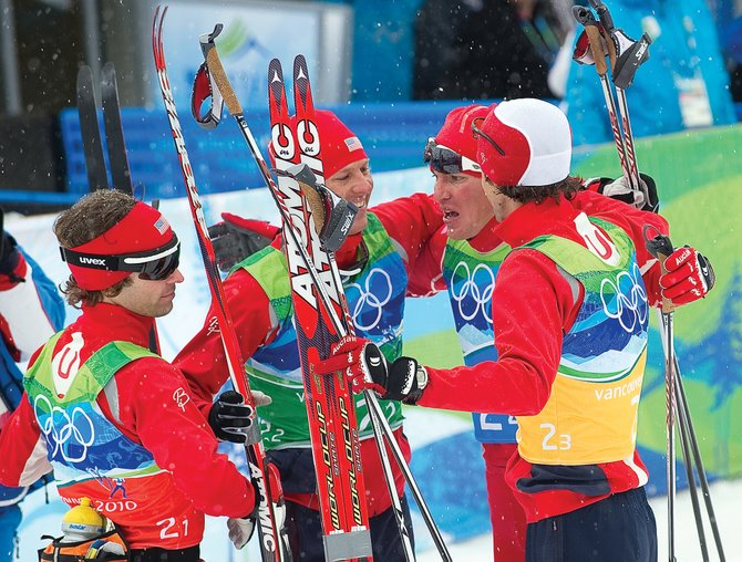 Johnny Spillane, from left, Billy Demong, Todd Lodwick and Brett Camerota celebrate after Tuesday's silver-medal performance in the team event. The U.S. Nordic Combined Ski Team's big three — Spillane, Demong and Lodwick — are unsure how long they will continue to compete.