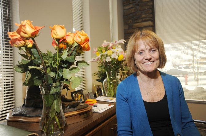 After a 39-year career in banking, Wells Fargo Community Bank President Jill Leary is retiring. Flowers from customers and coworkers decorate a tabletop in her office.