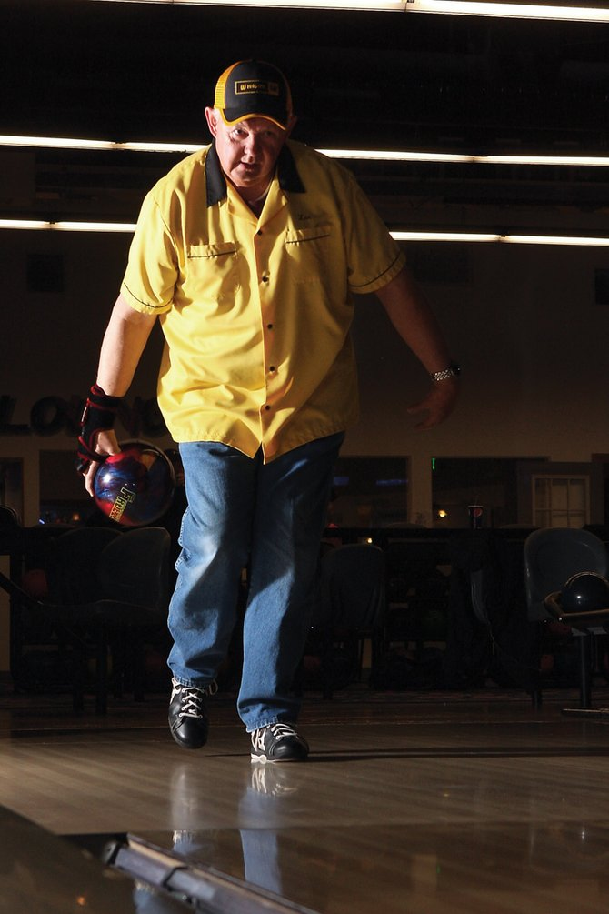 On Dec. 10 and Feb. 24, Les Shirkey bowled 300 at Thunder Rolls Bowling Center in Craig. Shirkey posed for this picture Wednesday before playing in the men's league at Thunder Rolls, where his Country Living Realty team sits in fifth place.