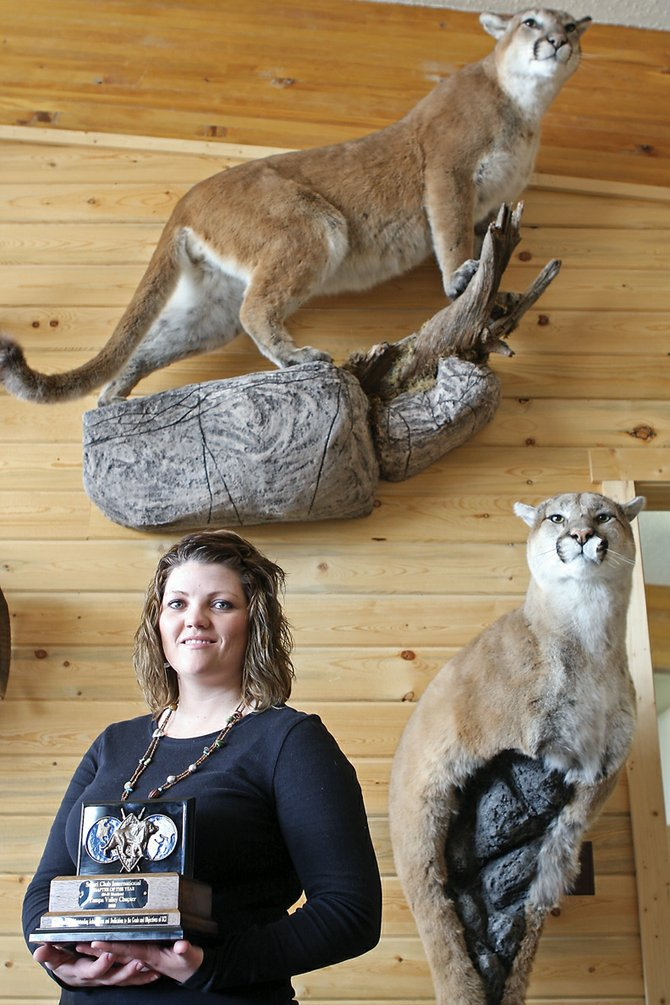 Jenni Reinier stands in Big Cat Taxidermy, the shop she and her husband, Leland, own in Craig. The shop also serves as headquarters for the Yampa Valley Chapter of Safari Club International, which, in its second year, won Chapter of the Year for chapters with 25 to 50 members at SCI's annual national convention.