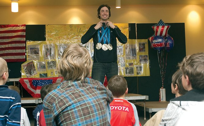 Three-time Olympic silver medalist Johnny Spillane took a few minutes away from his busy schedule Wednesday to visit with children at the Lowell Whiteman Primary School. Spillane's mother, Nancy, is the head of school at Whiteman Primary.
