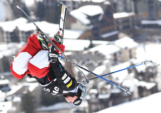 U.S. Ski Team member Joey Discoe flies off the top kicker Thursday during the single moguls competition of the NorAm Cup event at Steamboat Ski Area. Discoe placed second.