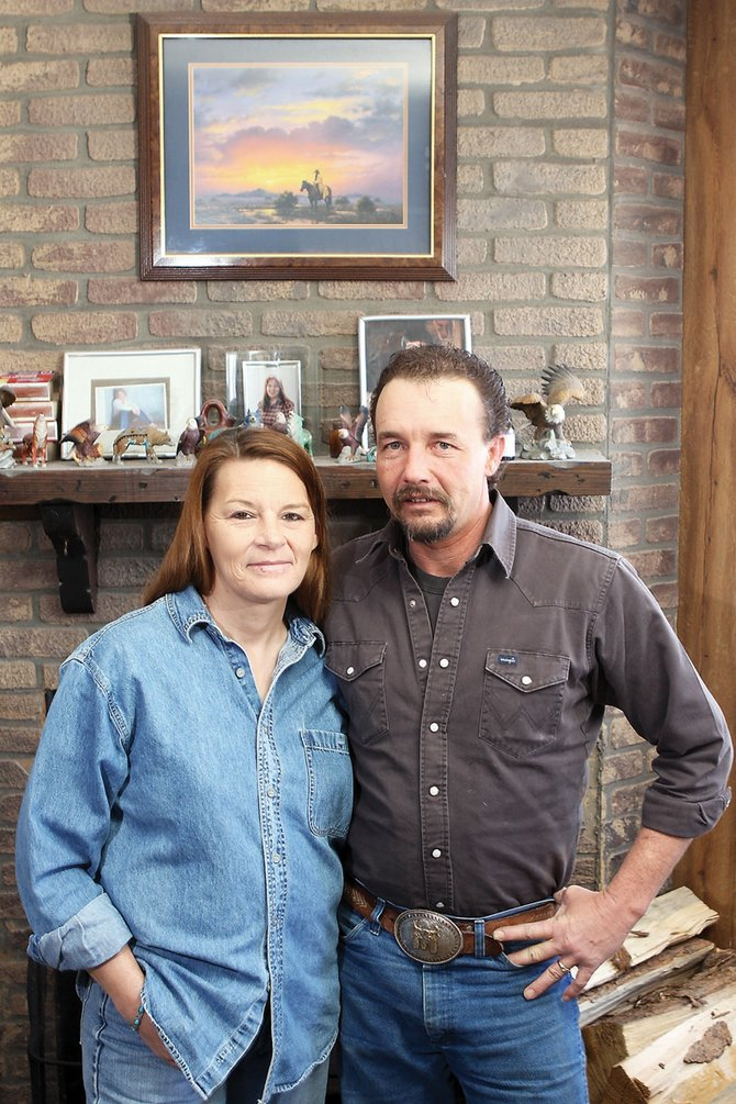 Tami and Rick Barnes stand Thursday in front of the fireplace inside their home on Moffat County Road 174. Tami, a Republican, is running for the Moffat County Commission District 2 seat against incumbent Audrey Danner.