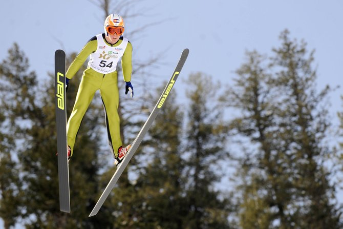 Steamboat Springs Winter Sports Club athlete Cliff Field makes a 72-meter jump Thursday while competing in the ski jumping portion of the 2010 Ski Jumping and Nordic Combined Junior Olympics at Howelsen Hill.