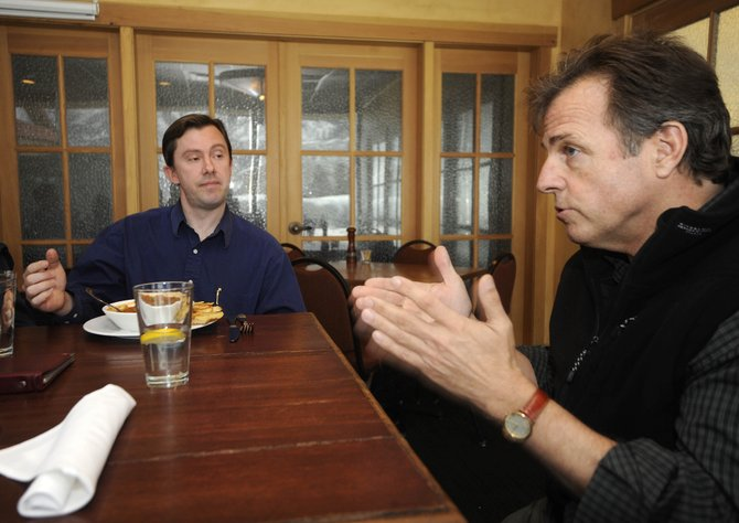 Local religious leaders Tim Olmsted, right, of the Buddhist Center of Steamboat, and First Baptist Church of Steamboat Pastor Jason Clark have a discussion Thursday at Rex's American Grill and Bar.