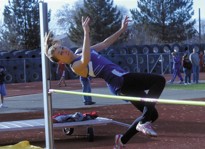 Junior Lauren Roberts clears the bar on her first high jump of the year. The Moffat County High School track team had its first meet of the season Friday at Stocker Stadium in Grand Junction.