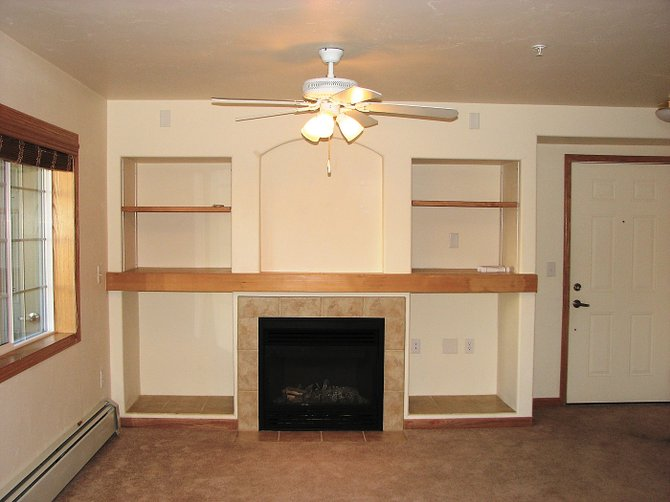 The condominiums at Sunray Meadows include touches such as ceiling fans, built in cabinets and fireplaces.
