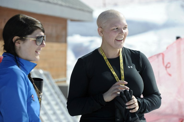 Sunshine Kids participant Kristine Duthie, right, shares a laugh with Steamboat Ski and Snowboard School instructor Jessica Koenig on Wednesday after skiing in the Desperado magic carpet area.
