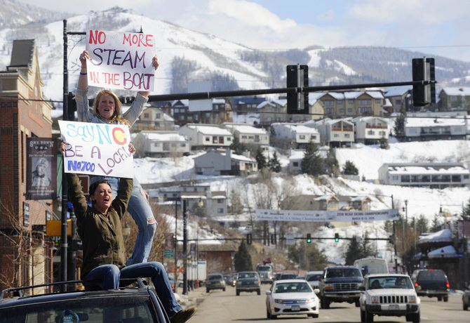 Steamboat Springs residents A.J. Pierson, left, and Alana Ratzell show their opposition to the Steamboat 700 annexation Tuesday in front of the Routt County Courthouse downtown.