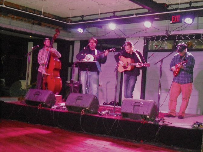 Local bluegrass band Cornbread is set to take the Ghost Ranch Saloon stage at 10:30 p.m. today for a free show. Band members shown here are Denton Turner, from left, Scott Kirton, Jay Roemer and Paul Geppert. John Huge joins the band today on dobro.