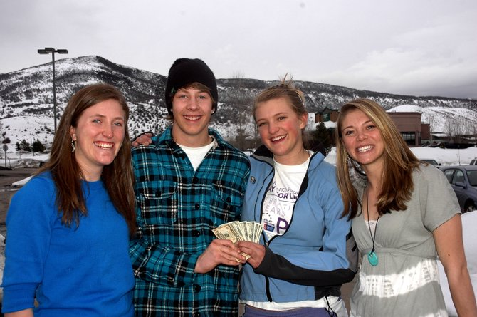 Four Steamboat Springs High School teens — from left, Meghan Lukens, Ty Hvambsal, Lilly Hoff and Jaime Winter — turned in $780 in cash they found at Steamboat Ski Area on Sunday. The envelope included the owner's information, and deputies gave the unidentified man his money back Monday afternoon.